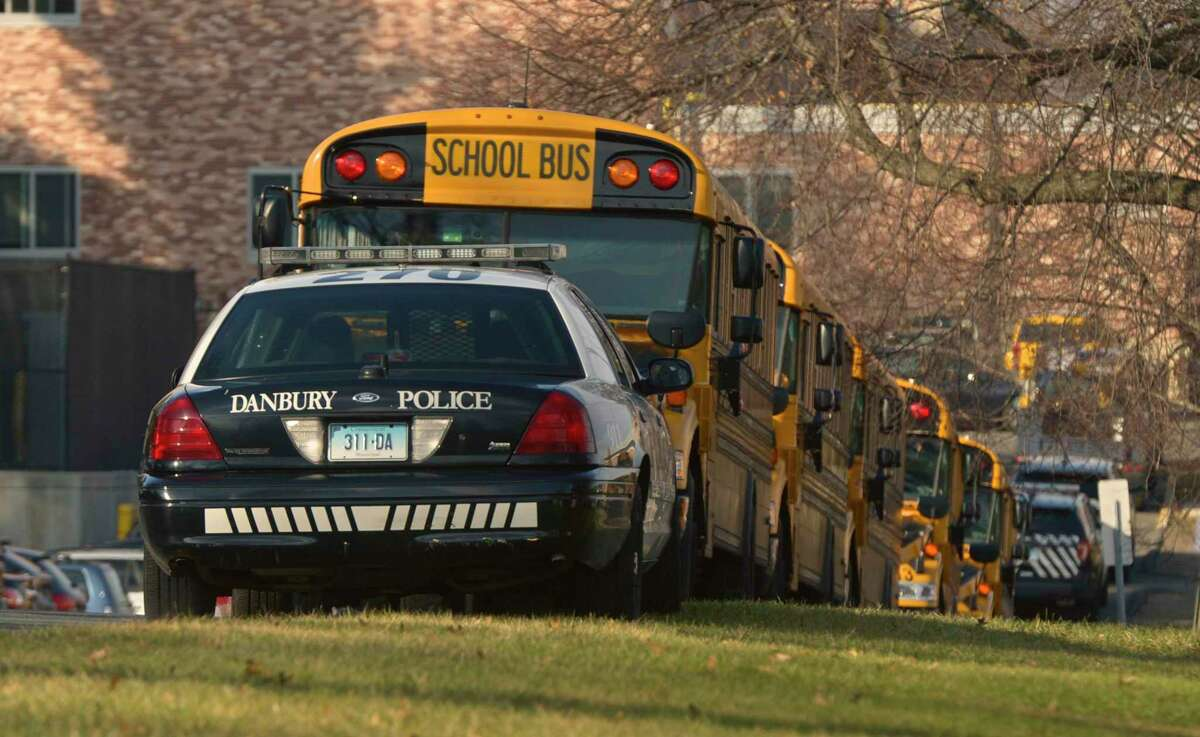 Danbury Police cruisers parked at Danbury High School on Monday afternoon. Multiple students are facing criminal charges and have been removed from the high school after an increase in fights between several small groups of students, officials said over the weekend. Monday, November 25, 2019, in Danbury, Conn.