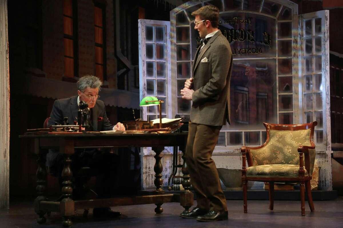 Robert Cuccioli, left, as Ebenezer Scrooge, and Matt Gibson, as Bob Cratchit, are seen here in Goodspeed Musicals'
