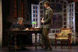 """Robert Cuccioli, left, as Ebenezer Scrooge, and Matt Gibson, as Bob Cratchit, are seen here in Goodspeed Musicals' """"A Connecticut Christmas Carol,"""" onstage at The Terris Theatre in Chester, Dec. 4 - 28."""