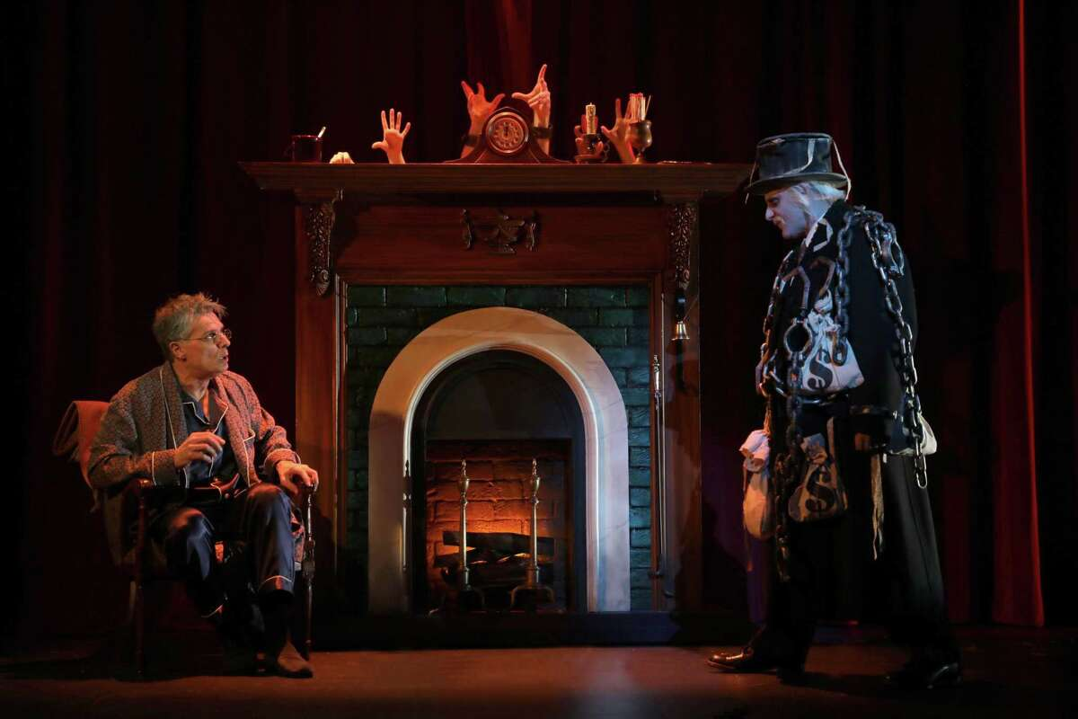 Robert Cuccioli, as Ebenezer Scrooge, and Michael Thomas, as the ghost of J. P. Morgan, are seen here in Goodspeed Musicals'