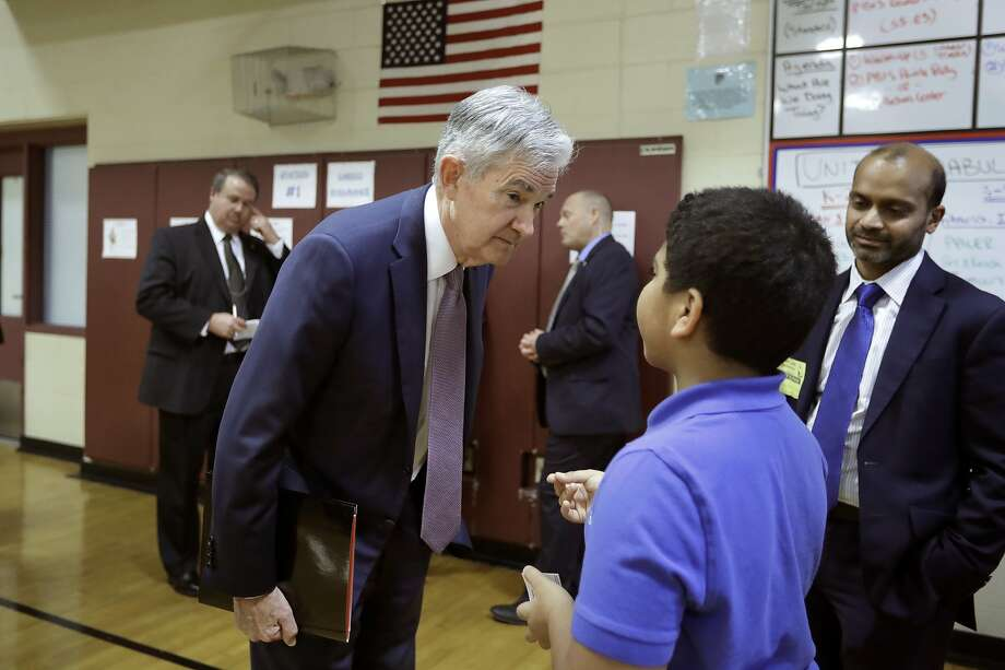 Federal Reserve Chairman Jerome Powell speaks with Brian Rosa, 11, who says he would like to be a banker. Photo: Photos By Steven Senne / Associated Press