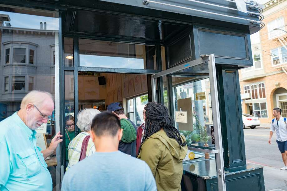 FILE - People wait in line to enter the crowded Tartine Bakery in the Mission District neighborhood of San Francisco, California; Tartine is among the most popular sourdough bread bakeries in San Francisco, Sept. 30, 2018. The bakery has opened its doors again following a forced closure due to a failed health inspection. Photo: Smith Collection/Gado/Getty Images