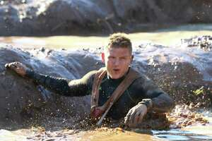 Cory Peek competes in the World's Toughest Mudder event on Friday, Nov. 15, in Atlanta. The 24-hour obstacle course race features 5-mile laps with obstacles that change throughout.