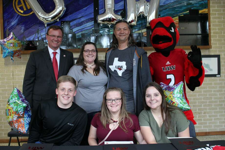 Pictured from front left to right in the back row are Thomas Evans, president of the University of the Incarnate Word, Karryn Peters, the mother of triplets, Paul Harris, Alamo Heights High School counselor, and the UIW mascot Red. Pictured from left to right in the front row are Matthew, Melanie and Madelyn Peters. UIW surprised the three students with college scholarships to the university on Thursday, Nov. 21. Photo: University Of The Incarnate Word