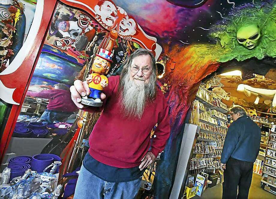 The late Bill Ziegler, who owned Wild Bill's Nostalgia Center on Newfield Street in Middletown, shows off a bobblehead doll in his likeness. Photo: Hearst Connecticut Media File Photo