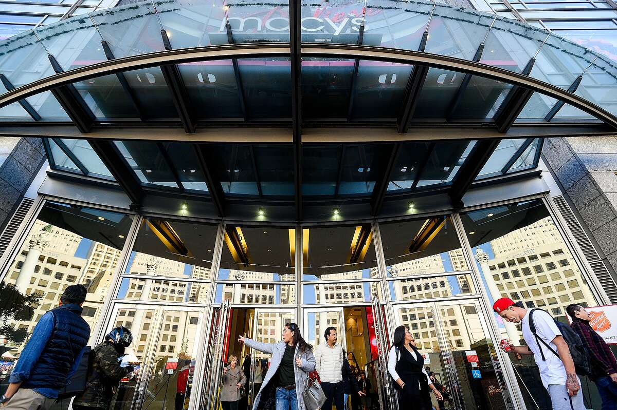 Shoppers leave Macy's Union Square store on Monday, Nov. 25, 2019, in San Francisco.