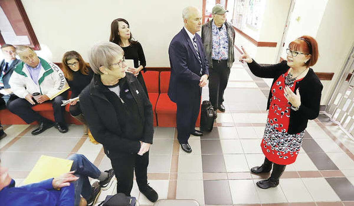 Madison County Clerk, Debra Ming-Mendoza, right, issues instructions Monday morning to candidates waiting to file for election outside her offices in the Madison County Administration Building in Edwardsville.