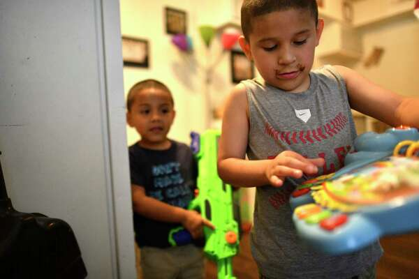 Brothers Leroy, now 7, and Noah Gomez, 4, play in the apartment from which their family might be evicted.