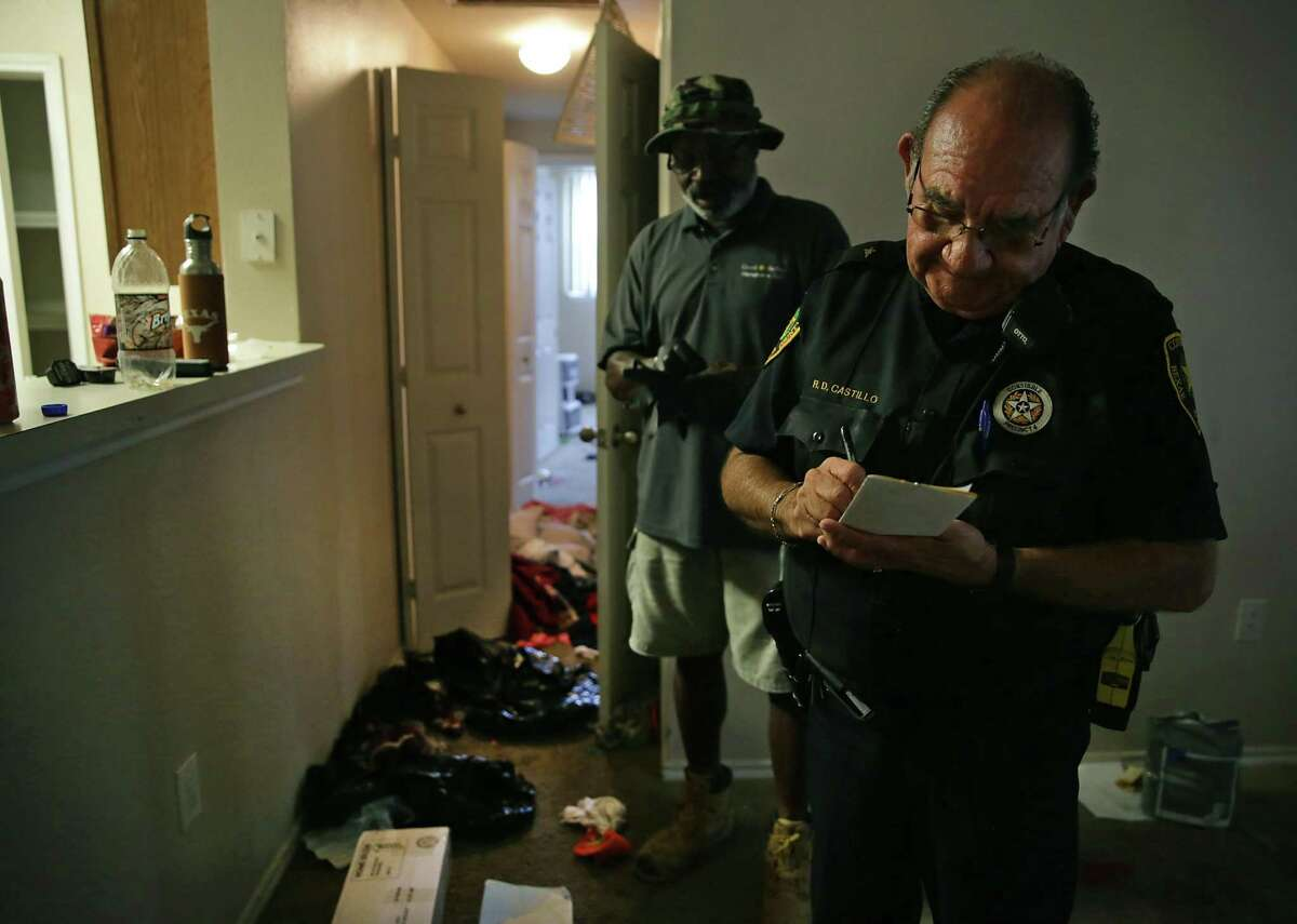 Deputy Constable Castillo and one of the movers hired by the complex get ready to remove the possessions.