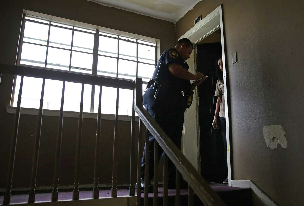 Bexar County Deputy Constable Edward Prado serves an eviction notice at Spanish Oaks Apartments on the North Side. The following photos are from