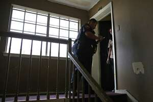 Bexar County Deputy Constable Edward Prado serves an eviction notice at Spanish Oaks Apartments on the North Side, which is owned by Bexar Met Property Management. Bexar Met's properties evicted more than 700 tenants, equating to about or one-fourth of their rental units.