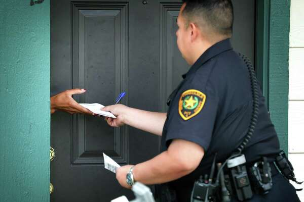A Bexar County deputy constable serves an eviction citation to a tenant in November. A reader ponders who is in the wrong in some of these situations.