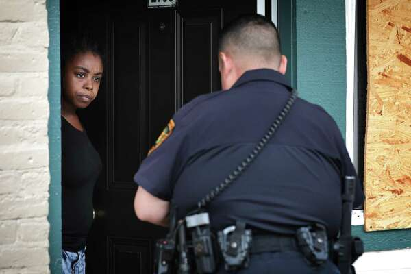 Prado serves an eviction citation to Patrice Daniels at Cottage Creek Apartments on the Northeast Side.