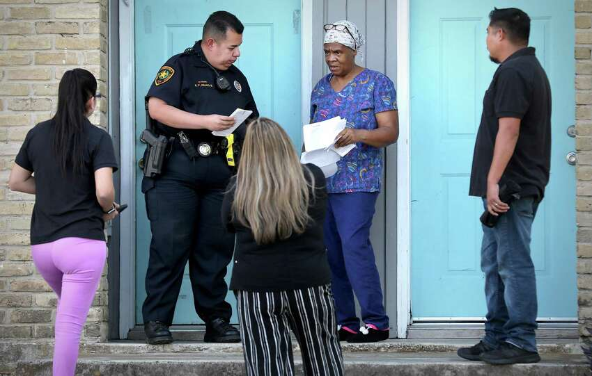 Prado, with a moving crew, is about to evict Patricia White from her apartment at Brooks Townhomes on the Southeast Side.