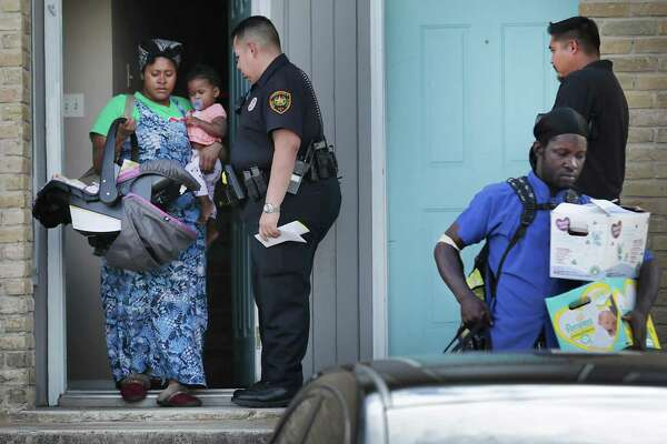 Bexar County Deputy Constable Edward Prado of Precinct 4 stands by as cohabitants of Patricia White leave White's apartment after she is served a writ of possession at Brooks Townhomes on Wednesday, Nov. 6, 2019. City Council XX a proposal to give renters 60 days to come up with rent if they're short during the COVID-19 crisis. Landlords would have to tell renters at least two months in advance that they plan to evict them for not paying.