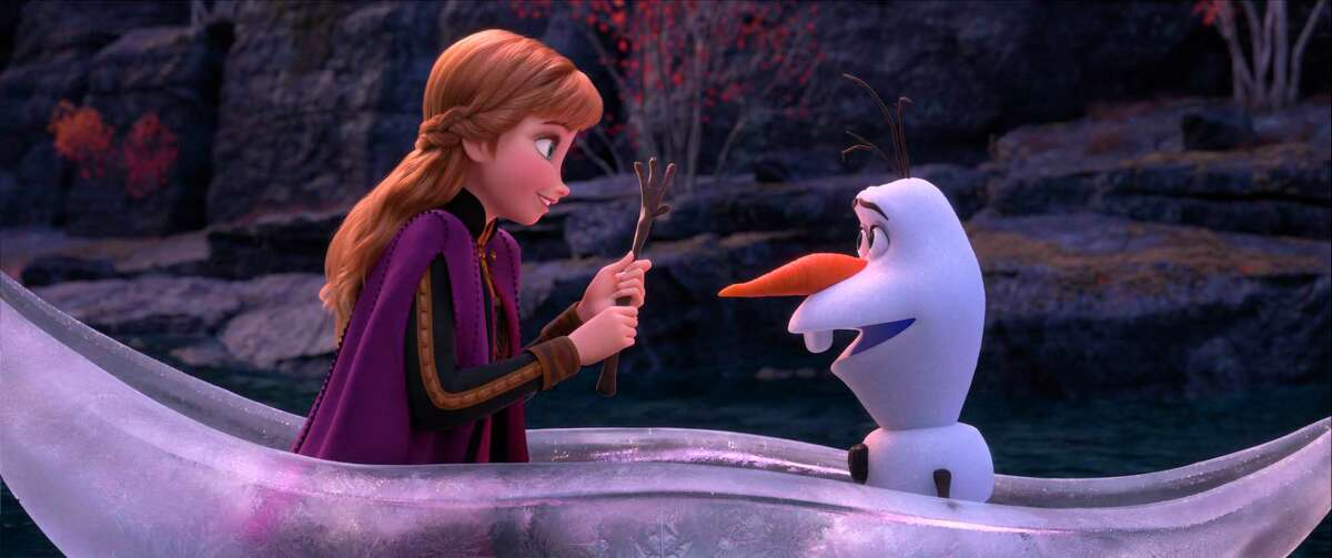This image released by Disney shows characters Anna, voiced by Kristen Bell, and Olaf, voiced by Josh Gad, in a scene from
