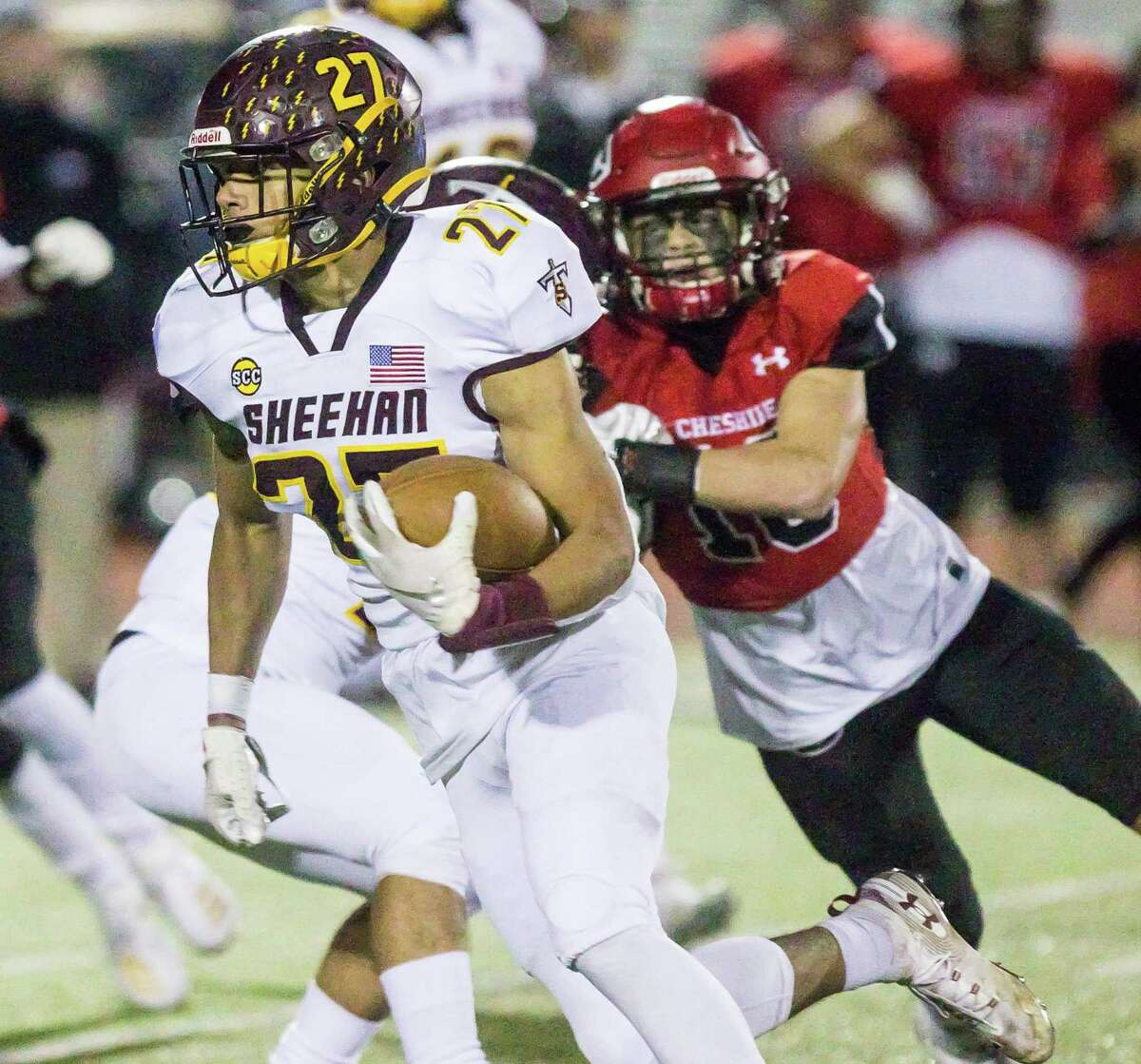 (John Vanacore/For Hearts Connecicut Media) Sheehan's Jordan Davis gets past Cheshire's Ben Wable for a big gain during Cheshire's win Friday night.