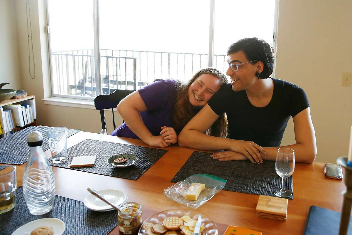 Laurel Saunders Estes (l to r) and Valerie Jade share a laugh as they visit at the home of Heather Saunders Estes (not shown) on Monday, October 28, 2019 in San Francisco, Calif.