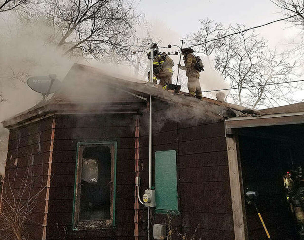 Fire crews worked Monday morning to extinguish a fatal residential fire in the 100 block of Second Avenue in Edwardsville.