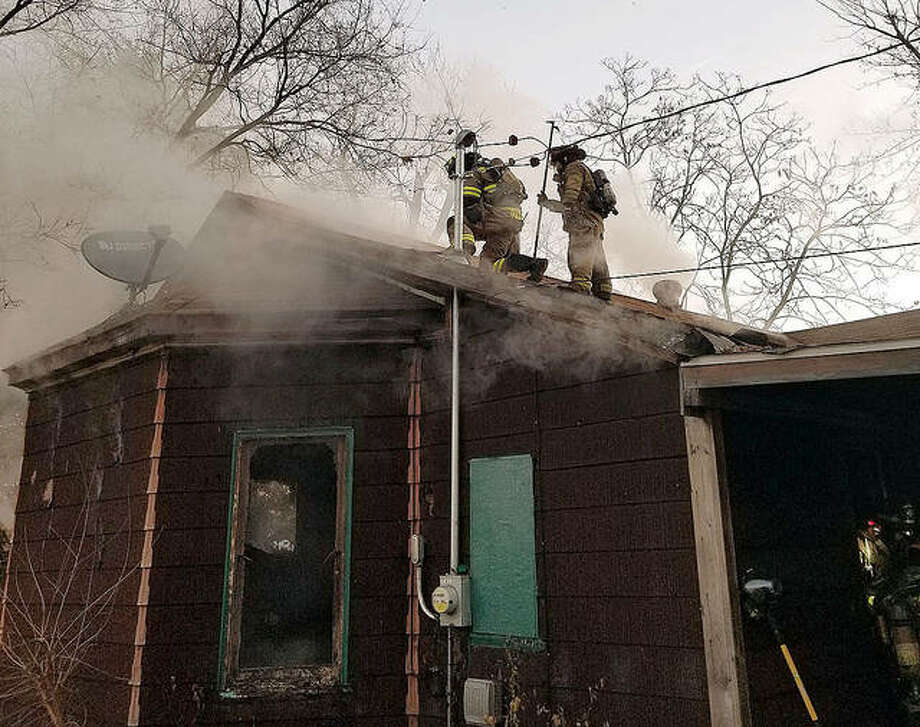 Fire crews worked Monday morning to extinguish a fatal residential fire in the 100 block of Second Avenue in Edwardsville. Photo: Courtesy Of The Edwardsville Fire Department