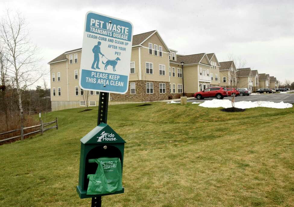 One of many dog waste bag dispensers and trash cans at Iroquois Village apartment complex where management is having trouble with dog owners not picking up after their dogs on the property on Monday, Nov. 25, 2019 in Niskayuna, N.Y. (Lori Van Buren/Times Union)