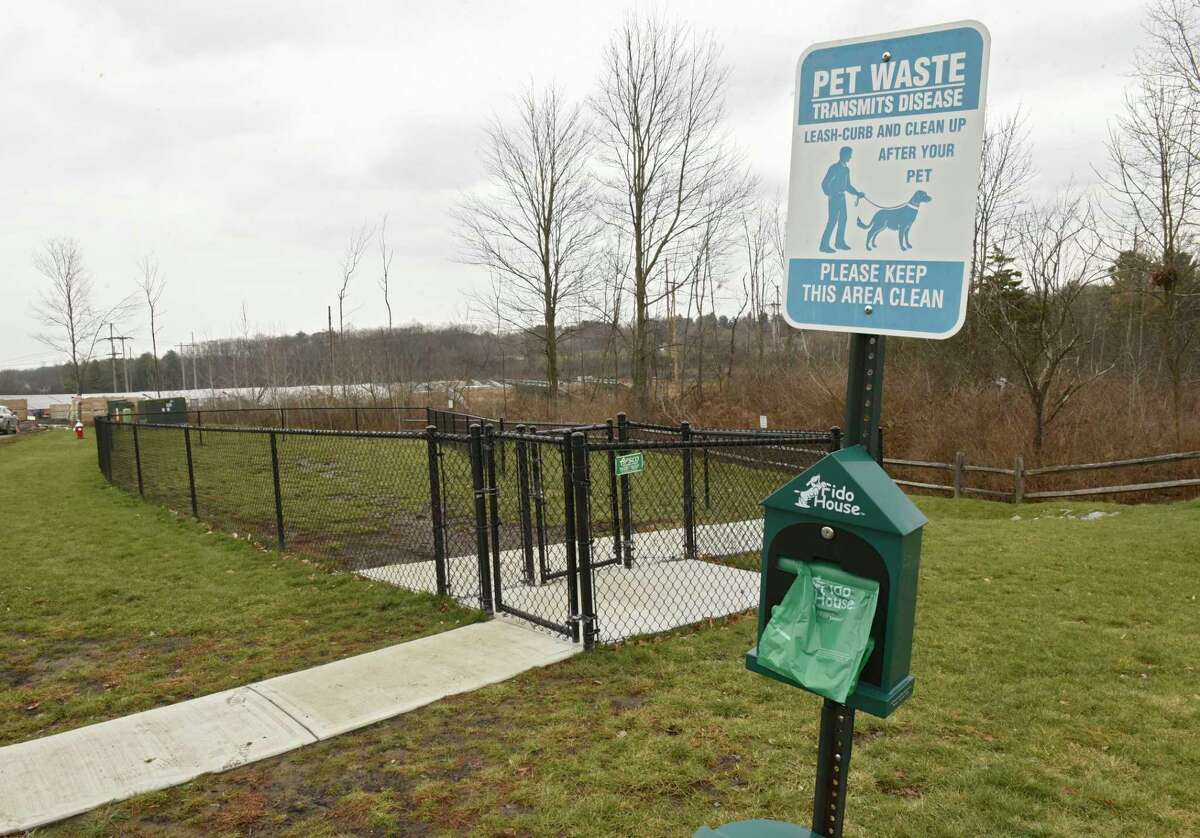 One of many dog waste bag dispensers and trash cans is seen near the dog park at Iroquois Village apartment complex where management is having trouble with dog owners not picking up after their dogs on the property on Monday, Nov. 25, 2019 in Niskayuna, N.Y. (Lori Van Buren/Times Union)
