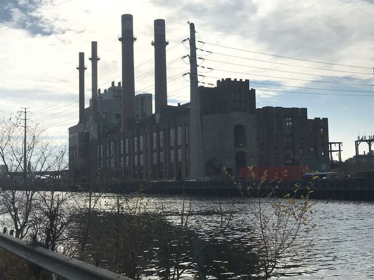 The former English Station power plant as seen from across the Mill River in New Haven's Fair Haven neighborhood