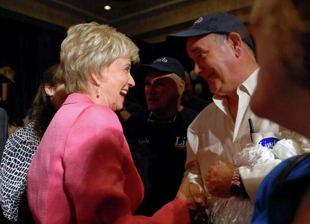 Republican candidate for the Senate Linda McMahon, left, celebrates her victory in the republican primary for U.S. Senate, Tuesday evening, August 10, 2010, at the Crowne Plaza Hotel, Cromwell, Connecticut. Photo: Bob Luckey / Greenwich Time