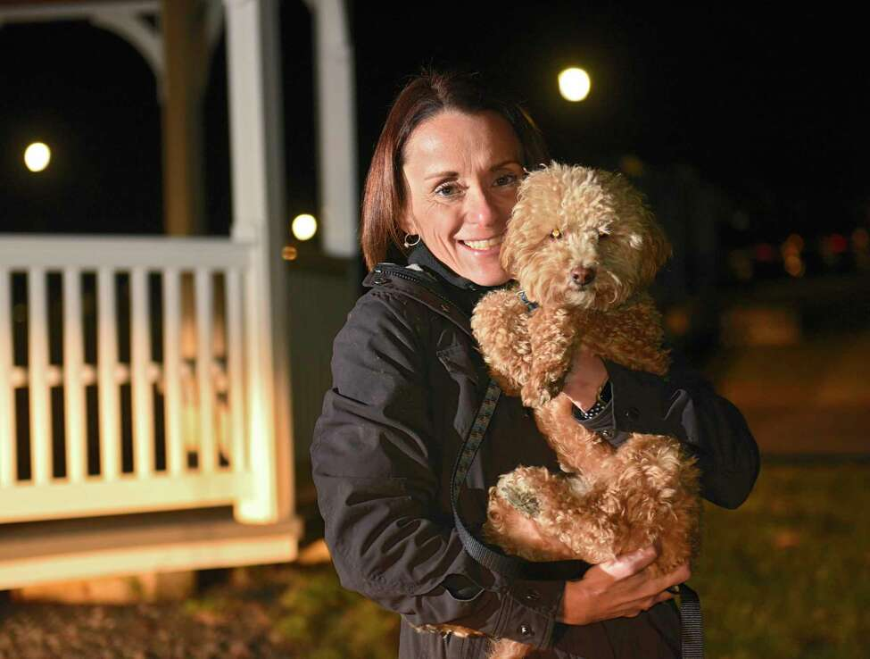 Angela Rosetti holds her dog Carter at Iroquois Village apartment complex where they live on Monday, Nov. 25, 2019 in Niskayuna, N.Y. Management sent an email to residents who own dogs stating that they need to provide a DNA sample from the pet to see who isn't picking after their dogs. (Lori Van Buren/Times Union)