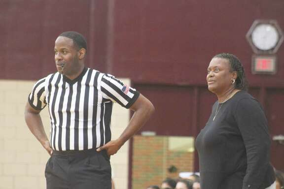 Lady Deer head coach Theresa White and a referee keep watch on the action on the court during the McDonald's Texas Invitational.