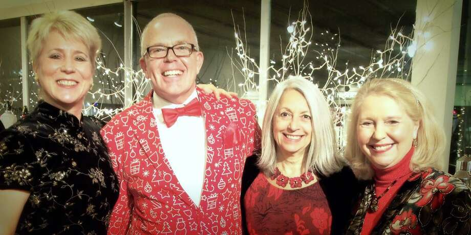 Deck the Halls party and fundraiser to benefit FISH of Northwest Connecticut, returns Dec. 4 to Five Points Gallery. Above, guests including FISH executive director Deirdre DiCara, Julia Scharnberg and Cathy Coyle enjoy the event in 2017. Photo: Contributed Photo /