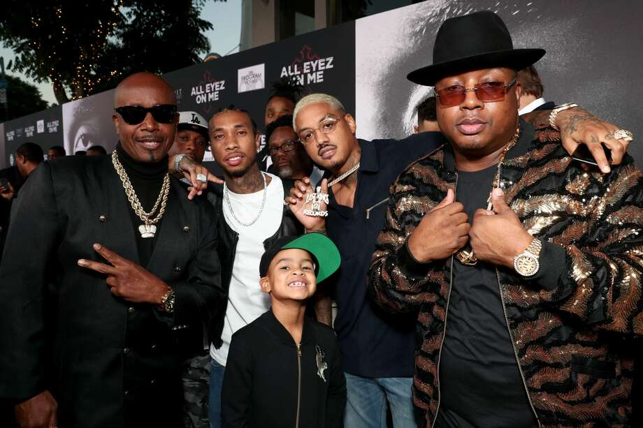 """(L-R) Recording artists MC Hammer, Tyga, guest, and recording artist E-40 at the """"ALL EYEZ ON ME"""" Premiere at Westwood Village Theatre on June 14, 2017 in Westwood, California. Photo: Todd Williamson"""