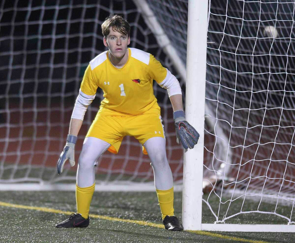 Greenwich goalie Padraig Colligan in goal against Hall in the CIAC Class LL boys soccer championship on Saturday at Veterans Memorial Stadium 19 in New Britian.