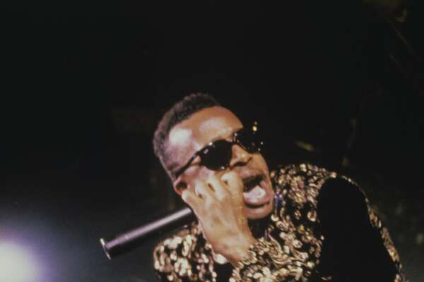 MC Hammer (Stanley Burrell), rapper, performing on stage, circa 1988.