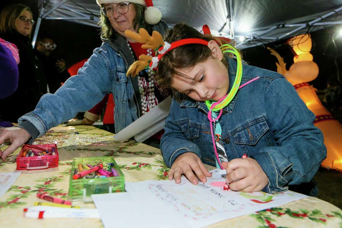 Sophia Carmony, 7, writes a letter to Santa during last year's Universal City Tree Lighting Ceremony. This year's ceremony is set for 6-8 p.m. on Tuesday, Dec. 3, in front of City Hall, 2150 Universal City Blvd.