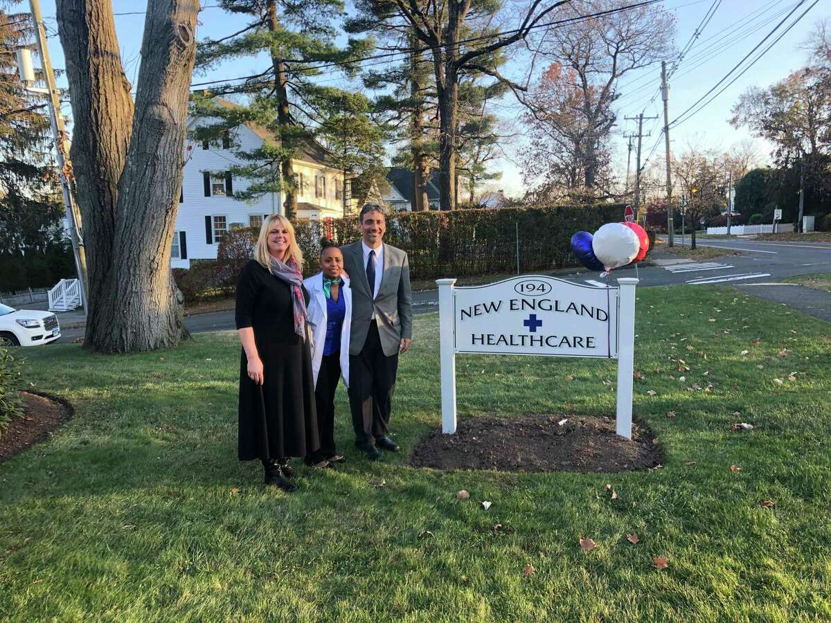 Wife Lauren Dayya and medical assistant Greer Lauture join Dr. David Dayya at the opening of New England HealthCare on South Avenue in New Canaan.