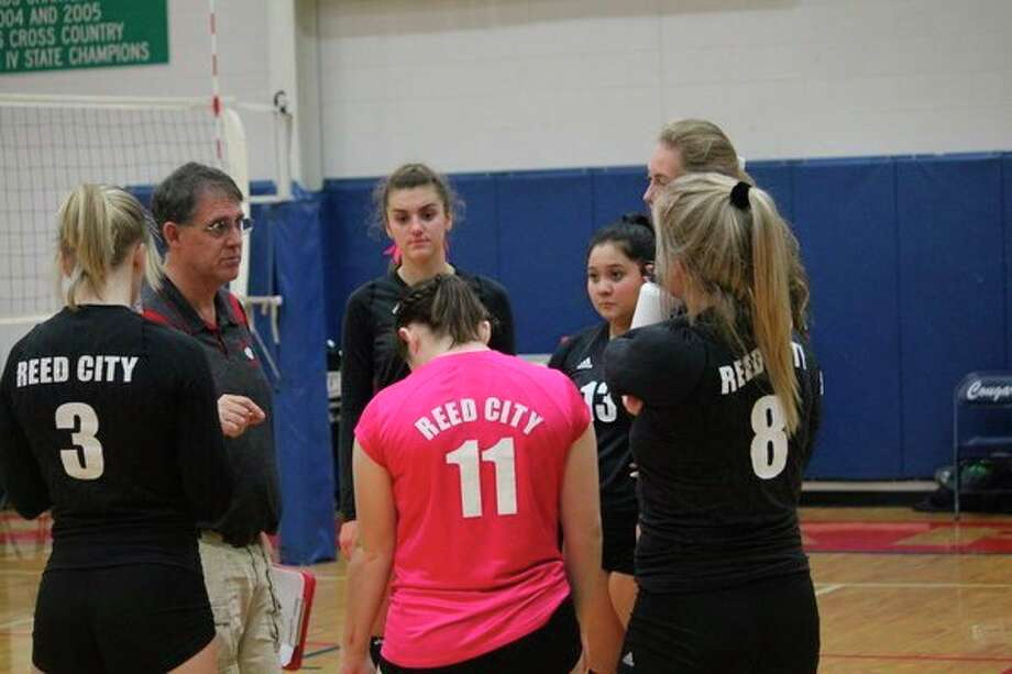 Reed City volleyball coach Don Patterson (left) talks to his team during the season. (Pioneer photo/John Raffel)