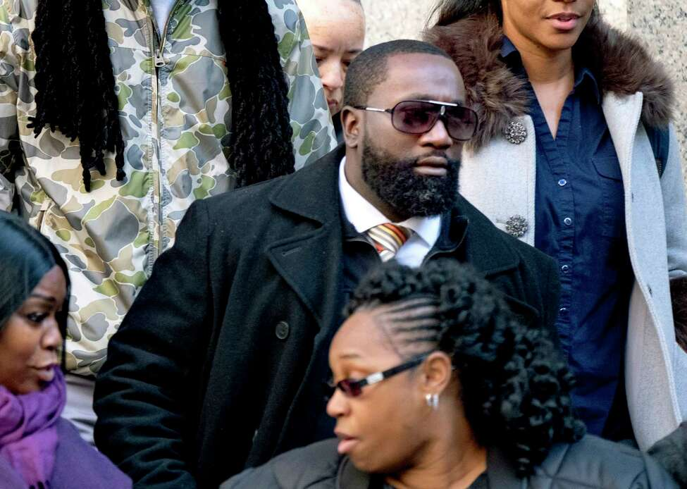 Michael Thomas, a federal jail guard responsible for monitoring Jeffrey Epstein the night he killed himself, leaves federal court Monday Nov. 25, 2019, in New York. He faces charges for falsifying prison records in the hours surrounding Epstein's death. (AP Photo/Craig Ruttle)