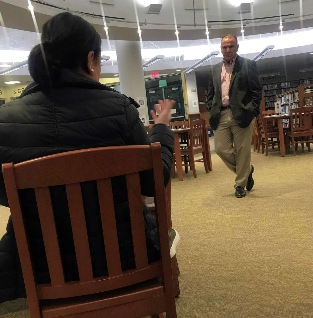 Joseph Erardi, of JE Consulting, fields questions from parents in Staples High School's library. Taken Nov. 25, 2019 in Westport, Conn.