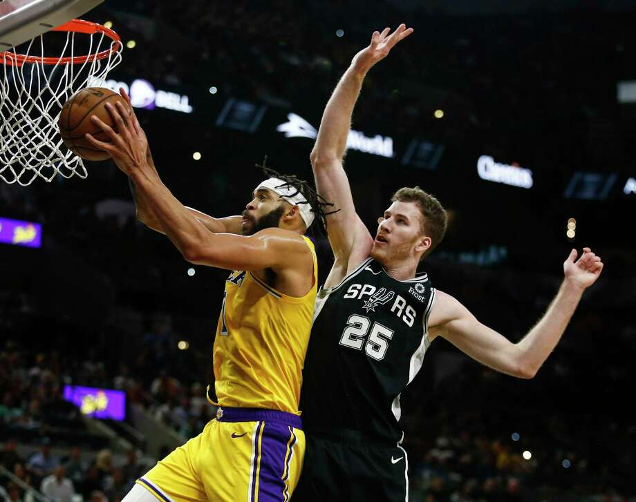 Los Angeles Lakers' JaVale McGee grabs the rebound as San Antonio Spurs' Jakob Poeltl tries to block him as the Spurs play the Los Angeles Lakers at AT&T Center in San Antonio, Texas on Nov. 25, 2019. Photo: Josie Norris, San Antonio Express-News / Staff Photographer / **MANDATORY CREDIT FOR PHOTOG AND SAN ANTONIO EXPRESS-NEWS/NO SALES/MAGS OUT/TV