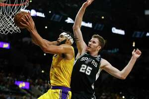 Los Angeles Lakers' JaVale McGee grabs the rebound as San Antonio Spurs' Jakob Poeltl tries to block him as the Spurs play the Los Angeles Lakers at AT&T Center in San Antonio, Texas on Nov. 25, 2019.