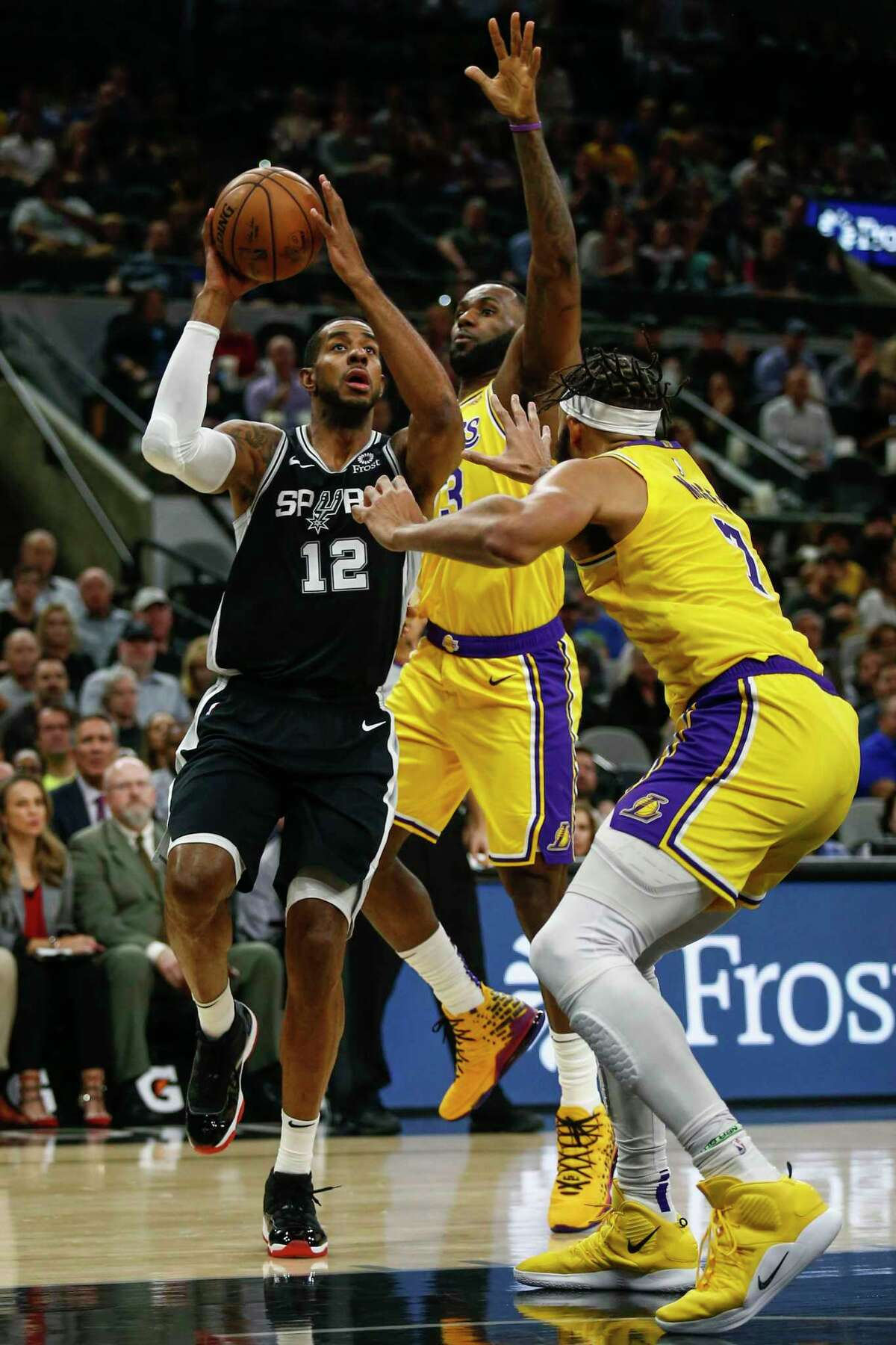 San Antonio Spurs' LaMarcus Aldridge goes for a shot as he is backed by Los Angeles Lakers' Lebron James and JaVale McGee as the Spurs play the Los Angeles Lakers at AT&T Center in San Antonio, Texas on Nov. 25, 2019.