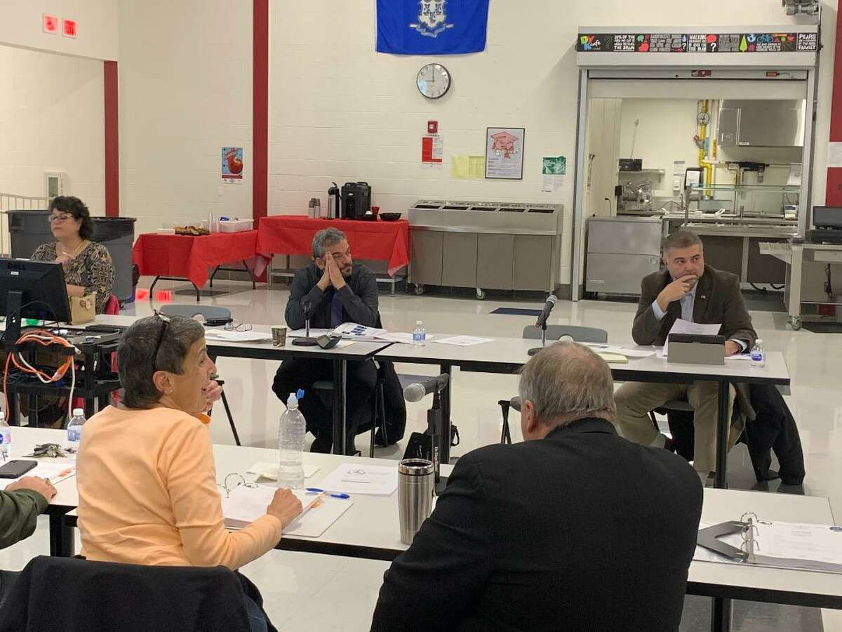 Members of the Ansonia Derby Temporary School Regionalization Study Committee weigh findings of cost savings and expenditures in two reports released Monday night by their consultant.