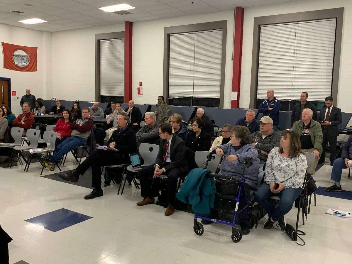 Nearly 40 people turned out Monday night to hear the initial findings of the District Management Group in their study of savings and expenditures in regionalization the Ansonia and Derby Schools.