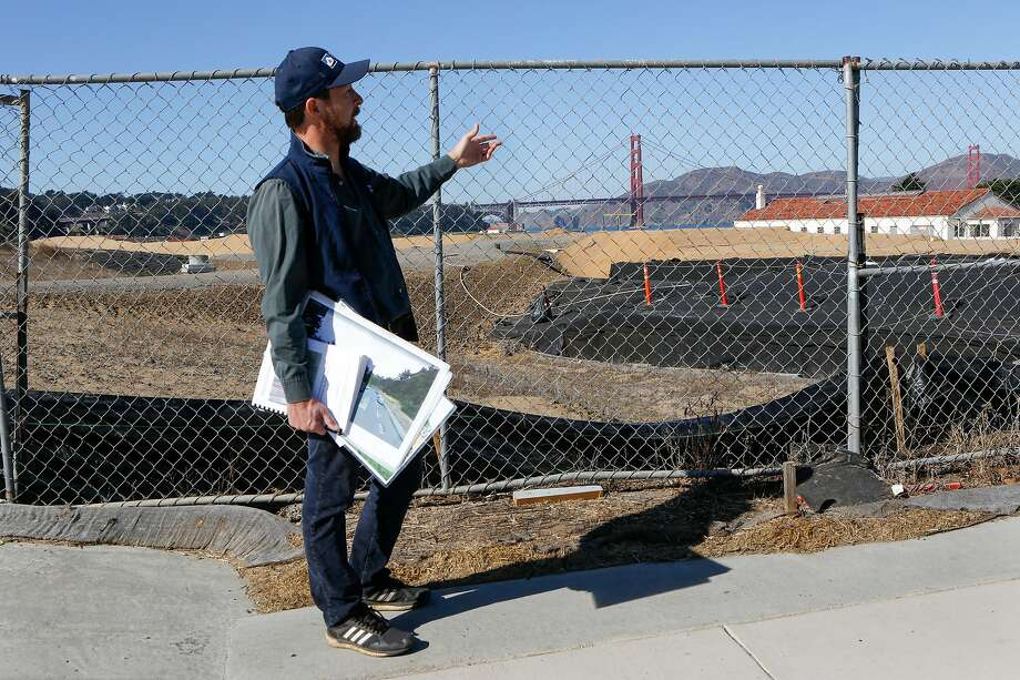 Lewis Stringer, associate director of natural resources at Presidio Trust, explains the next big project of restoration and land use, the Tunnel Top Project, within the Tennessee Hollow Watershed in San Francisco, Calif. on Thursday, Oct. 30, 2019. When the National Park Service took over, the Presidio was a patchwork of landfills, old ammunition dumps, scarred landscapes, creeks relegated to pipes and lots and lots of non-native and imported plants.  After 25 years of  restoration, the habitat looks a lot more like it should -- coastal dunes, dune scrub, native grassland and oak woodlands. Photo: Amy Osborne / Special To The Chronicle