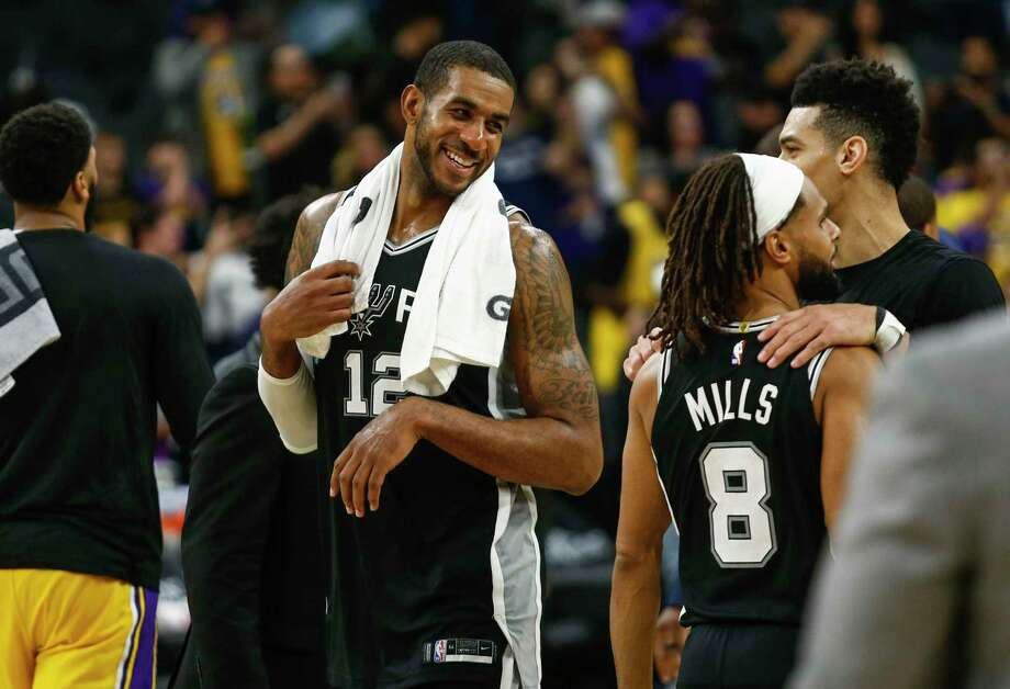 San Antonio Spurs' LaMarcus Aldridge smiles at teammates after the Spurs' game against the Lakers at AT&T Center in San Antonio, Texas on Nov. 25, 2019. Photo: Josie Norris, San Antonio Express-News / Staff Photographer / **MANDATORY CREDIT FOR PHOTOG AND SAN ANTONIO EXPRESS-NEWS/NO SALES/MAGS OUT/TV