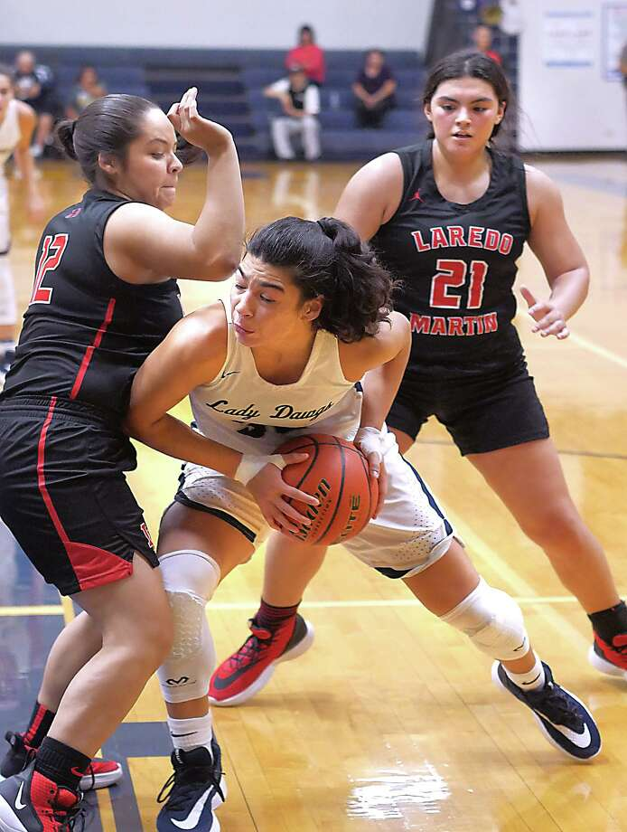 Aly Benavides and Alexander picked up a 63-30 victory over Jaritza Garcia, Alejandra Villanueva and Martin at home Monday. It was the sixth game in a stretch of seven in six days for AHS. Photo: Cuate Santos /Laredo Morning Times / Laredo Morning Times