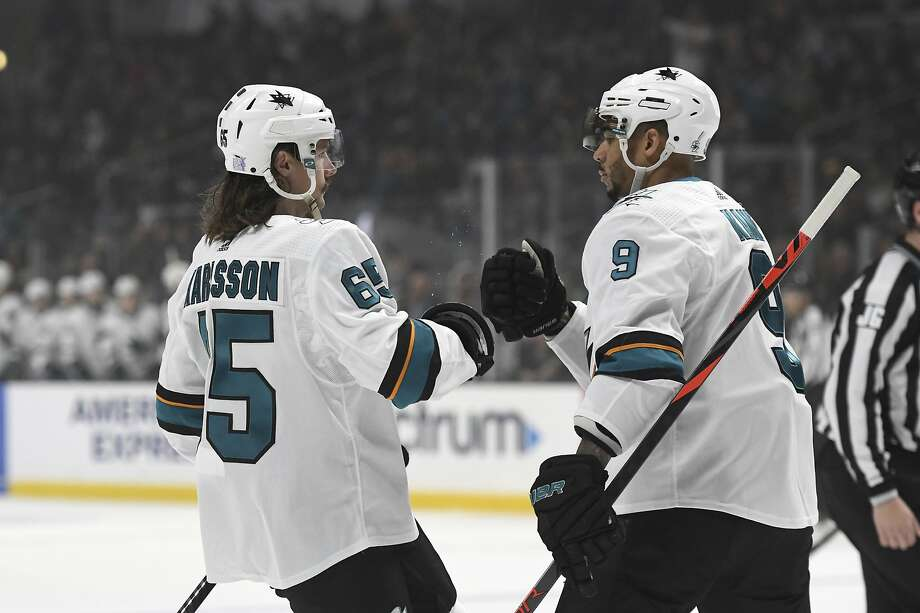 Erik Karlsson (left) is congratulated by Evander Kane after a goal against Los Angeles. The Sharks game ended too late for this edition. For details, see sfchronicle.com/sports. Photo: Michael Owen Baker / Associated Press