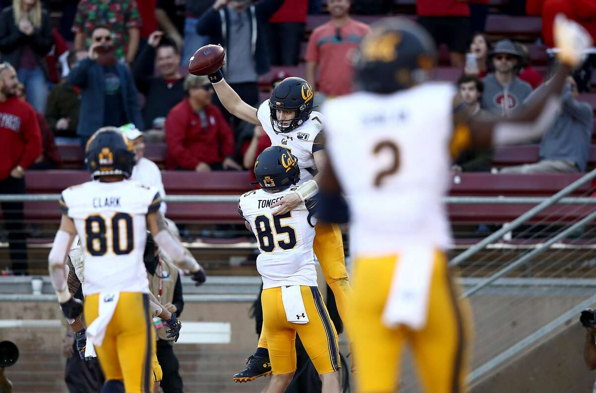 PALO ALTO, CALIFORNIA - NOVEMBER 23: Chase Garbers #7 of the California Golden Bears is congratulated by teammates, including Jake Tonges #85, after he ran in for the winning touchdown against the Stanford Cardinal at Stanford Stadium on November 23, 2019 in Palo Alto, California. (Photo by Ezra Shaw/Getty Images)