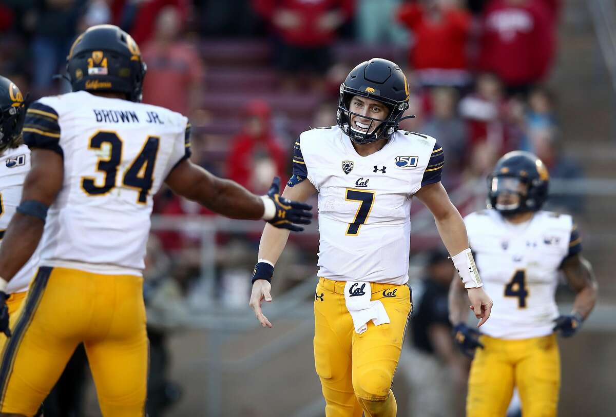 PALO ALTO, CALIFORNIA - NOVEMBER 23: Chase Garbers #7 of the California Golden Bears is congratulated by Christopher Brown Jr. #34 after he ran in for the winning touchdown against the Stanford Cardinal at Stanford Stadium on November 23, 2019 in Palo Alto, California. (Photo by Ezra Shaw/Getty Images)